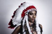 American Indian woman model girl studio portrait wearing war bonnet — Fotografia Stock