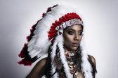 American Indian woman model girl studio portrait wearing war bonnet — Stock Photo