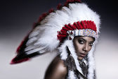 American Indian woman model girl studio portrait wearing war bonnet — Foto de Stock