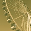 Ferris wheel in yellow — Stock Photo