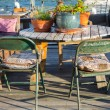 Table and chairs in sunset — Stock Photo