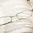 Reading glasses and dictionary — Stock Photo