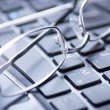 Glasses on keyboard — Stock Photo #31332839