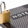 Padlock on notepad — Stock Photo
