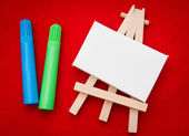 Wooden easel with white area — Stock Photo