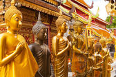 Gold statues of Buddha in a temple Doi Suthep — Stock Photo