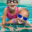 Royalty-Free Stock Photo: Two little girls playing in the pool