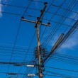 Electric pole with wires — Stock Photo