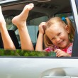 Stock Photo: Little girl sitting in the car