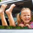 Little girl  sitting in the car - Stock Photo
