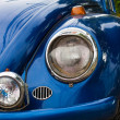Bumper and twin headlamps of classic blue rally car — Stock Photo