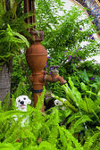 Old vintage water pump in the garden — Stock Photo