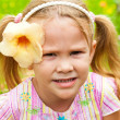 Girl with flower — Stock Photo #13293541