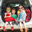 Three happy kids in the car — Stock Photo #14178458