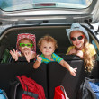Three happy kids in the car — Stock Photo #14178873