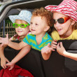 Three happy kids in the car — Stock Photo #14179316