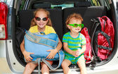 Two happy kids in the car — Foto Stock