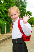 Young little girl preparing to walk to school — Stock Photo