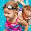 Little girl and little boy playing in the pool — Stock Photo #14831273
