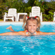 Little girl in the pool — Stock Photo #22348187
