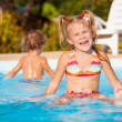 Little girl in the pool — Stock Photo #22348547
