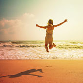 Happy child on the beach — Stok fotoğraf