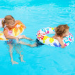 Children playing in the pool — Stock Photo