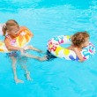 Foto Stock: Children playing in the pool