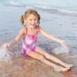 Adorable happy smiling girl on beach vacation — Stock Photo