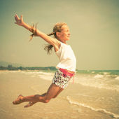Flying jump beach girl on blue sea shore in summer vacation — Stock Photo