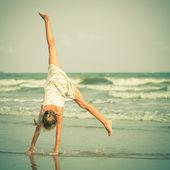 Beautiful girl having fun at beach — Stock Photo