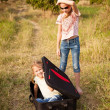 Two little girls with suitcase on the road — Stock Photo #27558719