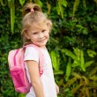 A young little girl preparing to walk to school — Stock Photo #30475813