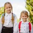 Two young little girls preparing to walk to school — Stock Photo #30476189