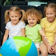 Three happy kids in the car — Stock Photo #30477623