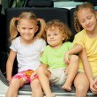 Three happy kids in the car — Stock Photo #30477633