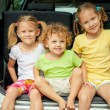 Three happy kids in the car — Stock Photo