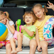 Three happy kids in the car — Stock Photo #30477753