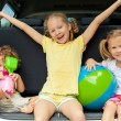 Three happy kids in the car — Stock Photo #30478109