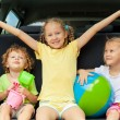 Three happy kids in the car — Stock Photo #30478125