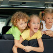Three happy kids in the car — Stock Photo #30479209