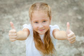 Happy girl shows gesture cool — Stock Photo