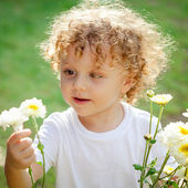 Little boy with flowers in hand — Stock Photo