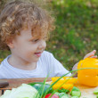 Little boy and vegetables on the table — Stock Photo