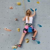 Little Girl Climbing Rock Wall — Stock Photo