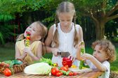 Children playing with vegetables — Stock Photo