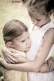 Two little sad girls — Stock Photo