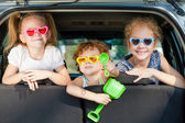 Two little girls and boy sitting in the car — Stock Photo