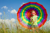 Girl on the nature with an umbrella in his hand — Stock Photo