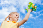 Little girl with toy airplane in hands — Stock Photo